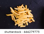 french fries on a dark... | Shutterstock . vector #666279775