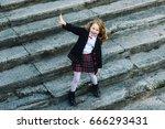 cheerful little girl in unifrom ... | Shutterstock . vector #666293431