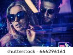 fashionable couple in a car  at ... | Shutterstock . vector #666296161