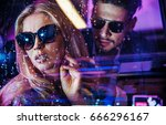 fashionable couple in a car  at ... | Shutterstock . vector #666296167
