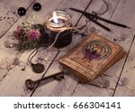black candle and old tarot...   Shutterstock . vector #666304141