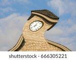 clock tower warped against a... | Shutterstock . vector #666305221