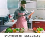 man cooking at kitchen making... | Shutterstock . vector #666325159