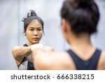 young asian athletic women in... | Shutterstock . vector #666338215