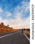 tourist on the mountain road  | Shutterstock . vector #666344419