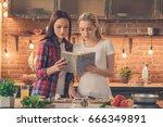 young women friends cooking... | Shutterstock . vector #666349891