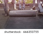 asia worker installing tar foil ... | Shutterstock . vector #666353755