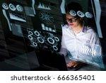 woman engineer looking at...