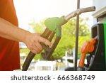 colorful petrol pump filling... | Shutterstock . vector #666368749