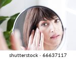 woman looking at herself in the ... | Shutterstock . vector #66637117