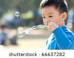 Little Boy Blowing Soap Bubbles