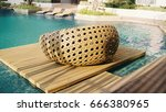 swimming pool with rattan sofa | Shutterstock . vector #666380965