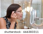 woman getting ready for work... | Shutterstock . vector #666383311