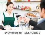 barista is making coffee at his ... | Shutterstock . vector #666408019