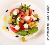 greek salad with fresh herbs... | Shutterstock . vector #666411004