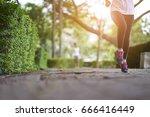 young woman runner feet running ... | Shutterstock . vector #666416449