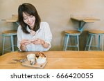 beautiful asian girl taking... | Shutterstock . vector #666420055