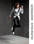handsome young man dancing on...   Shutterstock . vector #666430624