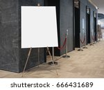 Small photo of Mock up Blank Poster on stand Elevator indoor building seminar information