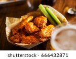 beer and hot buffalo chicken... | Shutterstock . vector #666432871