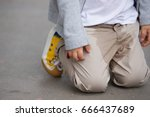 Small photo of A small toddler peeing on his pants on the street - Bed-wetting concept. Child pee on clothes.