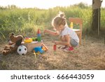 toddler girl playing with toys...   Shutterstock . vector #666443059