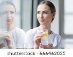 Happy Attractive Girl Drinking...