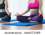 women doing yoga lotus pose ... | Shutterstock . vector #666471589