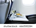 food served on board in airplane | Shutterstock . vector #666500284