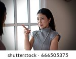 asian mom is scolding daughter   Shutterstock . vector #666505375