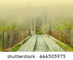 hazy bridge to the other side | Shutterstock . vector #666505975