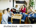 group of young people having a... | Shutterstock . vector #666552571