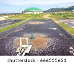 Small photo of Pool waste water treatment with Sludge are always air-filled, by aerator agitator inside factory.
