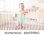 cute little baby standing in... | Shutterstock . vector #666559861