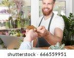 young handsome florist... | Shutterstock . vector #666559951
