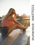 happy woman sitting in city... | Shutterstock . vector #666570211