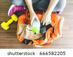 woman with bag and fitness... | Shutterstock . vector #666582205