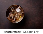 whiskey with ice. top view with ... | Shutterstock . vector #666584179