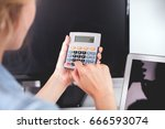 woman at home office using... | Shutterstock . vector #666593074