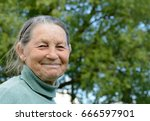 smiling elderly grandmother.... | Shutterstock . vector #666597901