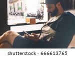 a bearded hipster guy is... | Shutterstock . vector #666613765