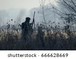 silhouette of the two hunters... | Shutterstock . vector #666628669