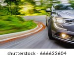 generic car driving in a curve | Shutterstock . vector #666633604