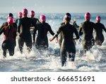 group triathlon participants... | Shutterstock . vector #666651691