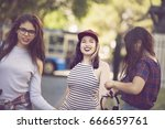 happy group of female friends... | Shutterstock . vector #666659761