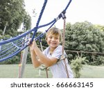 blond boy playing on a children ... | Shutterstock . vector #666663145