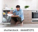 happy handsome man unloading... | Shutterstock . vector #666685291