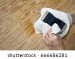 hands holding white cloth with... | Shutterstock . vector #666686281