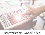sales person entering amount on ... | Shutterstock . vector #666687775