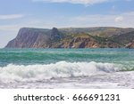 Small photo of Majestic eagre view in Crimea, Ukraine. Beautiful scenic sea washed against rocky shore with drops of white foam. Wavy landscape with cliffs and turquois water in Black sea in Eastern Europe.